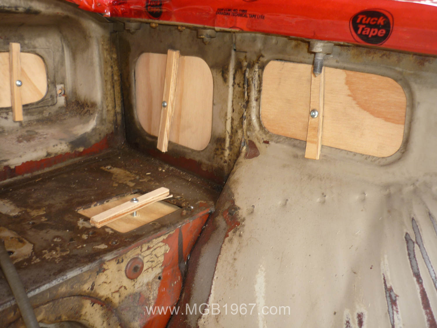 wooden blocks in the mgb gt engine compartment 1967 mgb gt